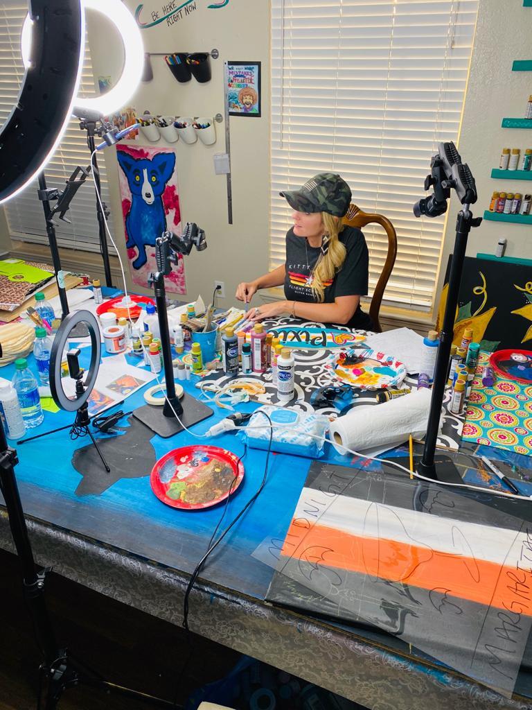Woman teaching paint parties live online