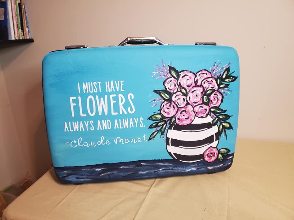 flowers in vase painted on vintage suitcase