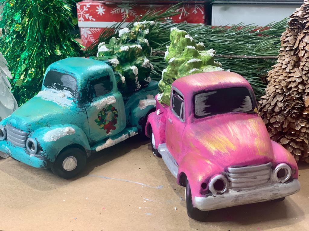 small ceramic truck with tree lanterns