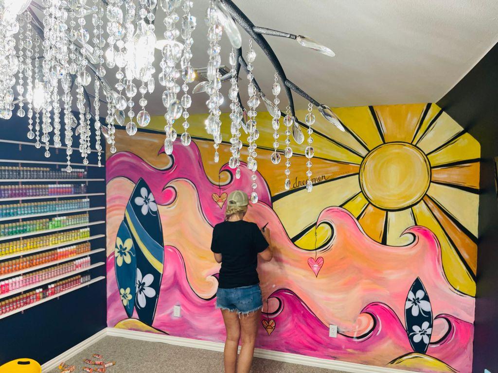 surf mural on art studio wall